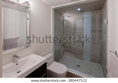 Modern bathroom in new luxury house - stock photo