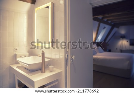 modern bathroom in old hotel  - stock photo