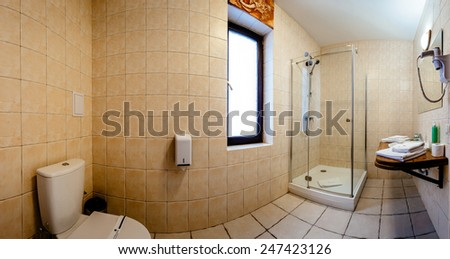 Modern bathroom in pastel colors. Shower cabin, basins, toilet. The horizontally position photo. - stock photo