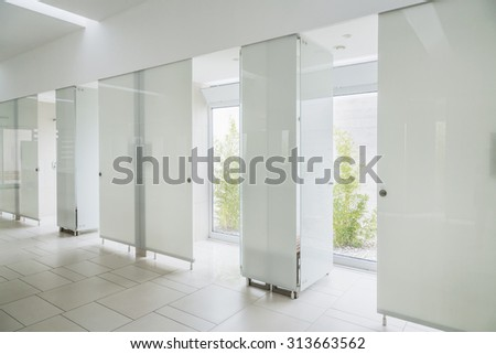 Modern bathroom interior in marble with glass door shower and window