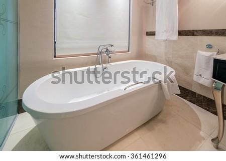 Modern bathroom interior with bathtub - stock photo