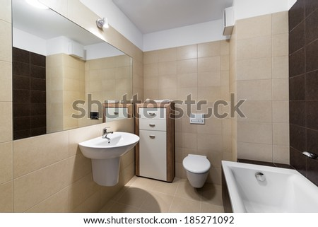Modern bathroom interior with classic ceramic fixtures - stock photo