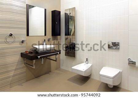 Modern bathroom interior with classic ceramic fixtures - stock photo