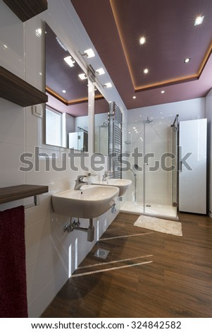 Modern bathroom interior with heated towel rail