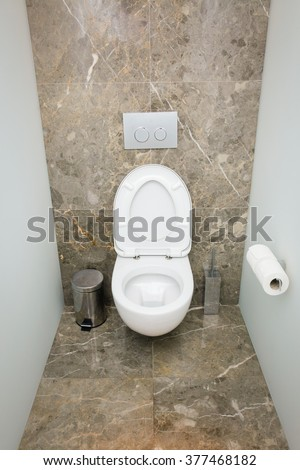 Modern bathroom or WC toilet interior, with clean detais and modern design - stock photo