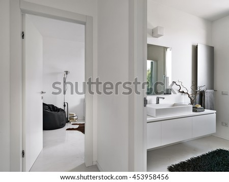 modern bathroom overlooking on the living room - stock photo