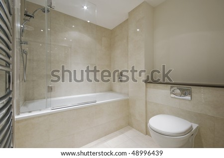 modern bathroom with floor to ceiling marble tiles - stock photo