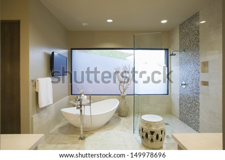 Modern bathroom with freestanding bath at home - stock photo