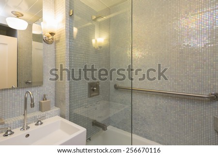 Modern bathroom with glass shower and Green Turquoise Squares Glossy Iridescent Glass Tile - stock photo