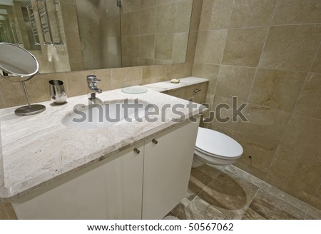 modern bathroom with marble finishing and large mirror - stock photo