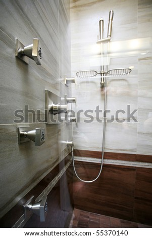 Modern bathroom with natural stone tiles. - stock photo