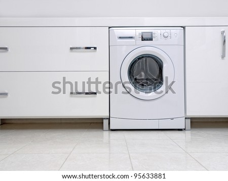 Washing machine stock images royalty free images for Kitchen cabinet washing machine