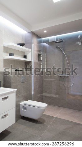 Modern bathroom with shower with glass door - stock photo