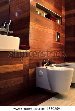 modern bathroom with wooden wall - stock photo
