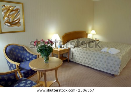 Modern Bedroom Decor in beige and blue - stock photo