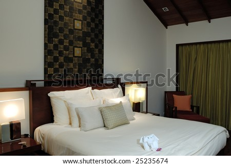 Modern bedroom in a resort - stock photo