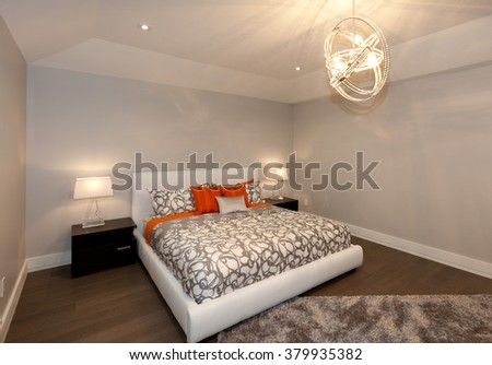 Modern bedroom in new luxury house - stock photo