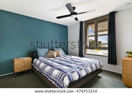 large bedroom maroon gray walls stock photo 60780310 - shutterstock