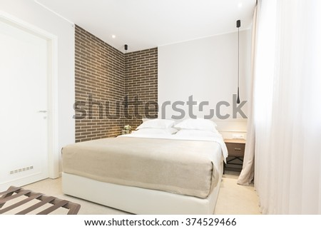 Modern bedroom interior in the morning - stock photo