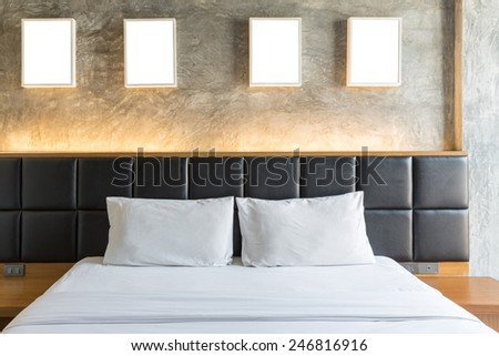 Modern bedroom with gray cement wall - stock photo