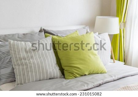 modern bedroom with green pillow on bed - stock photo