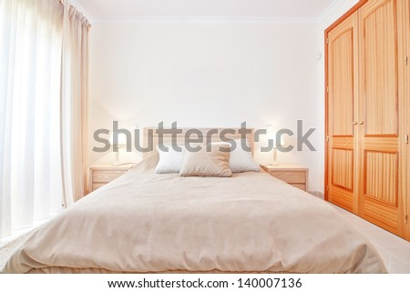 Modern bedroom with new bed. Front view. - stock photo