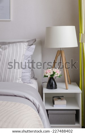 modern bedroom with wood lamp on table at home - stock photo