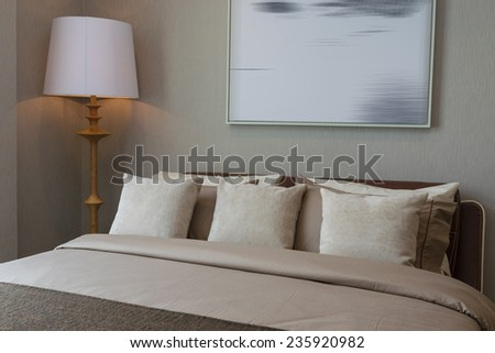 modern bedroom with wooden lamp and pillows - stock photo