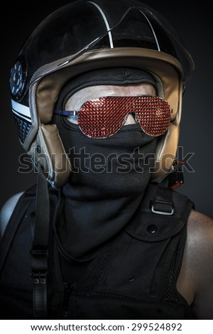 Modern biker with sunglasses red crystals and balaclava - stock photo