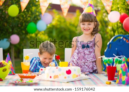Modern birthday party with colorful cake at backyard - stock photo
