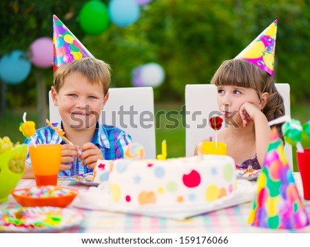 Modern birthday party with colorful cake at backyard