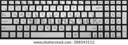Modern black and chrome laptop keyboard isolated - stock photo
