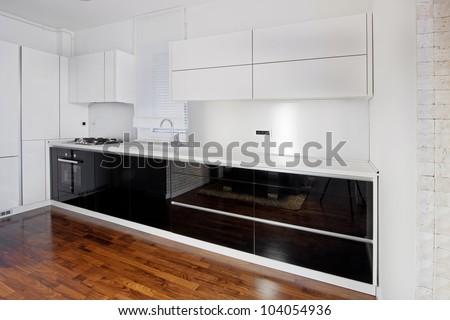 Modern black and white glossy kitchen - stock photo