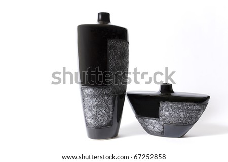 Modern black empty flower vase with ornate metallic pattern - stock photo