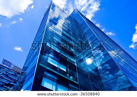 Modern black skyscraper and blue sky - stock photo