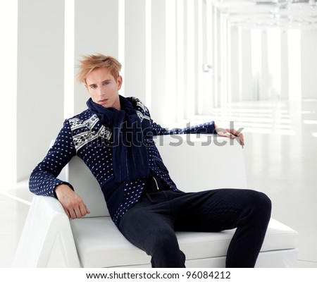 modern blond male futuristic sci-fi sitting in white indoor - stock photo