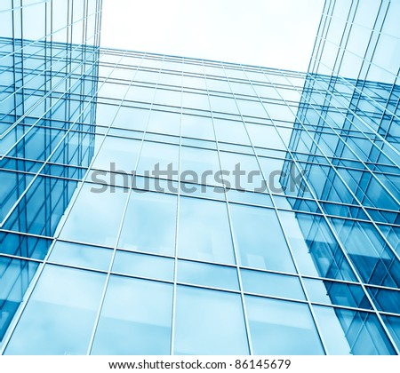 modern blue glass wall of skyscrapers
