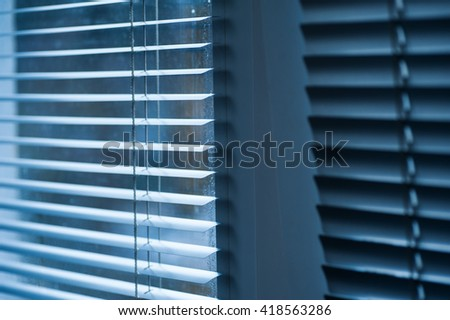 modern blue plastic Shutter Blinds in room close-up - stock photo