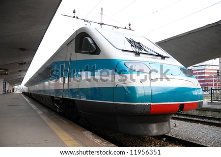 Modern Blue Train waiting on a Station - stock photo
