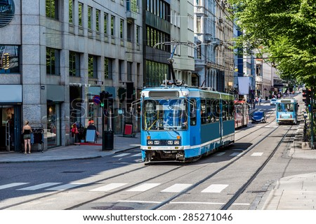 Modern blue tram in Oslo in Norway in a summer day - stock photo