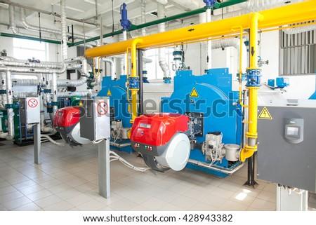 Modern boiler room equipment- high power boiler burner. Boiler room. Water heating. Power supply. Water supply. - stock photo