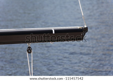 modern boom rope pulley, isolated against sea - stock photo