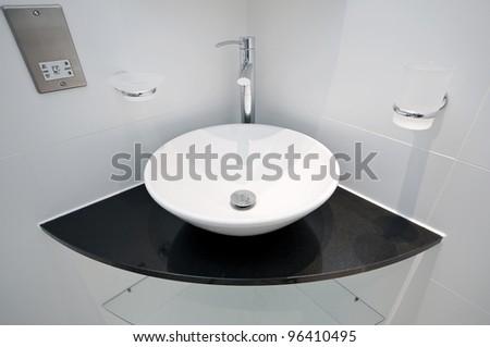 Modern Bowl Style Hand Wash Basin On A Granite Corner Shelf
