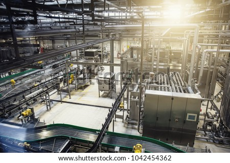 Modern brewery production line at beer factory. Steel tanks, equipment, pipelines and filtration system, toned