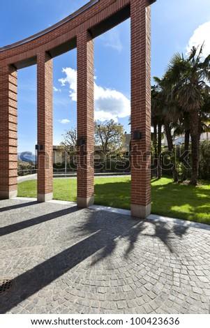 modern bricks house,  patio with columns - stock photo