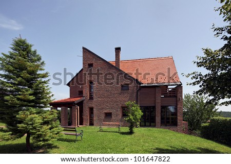 modern bricks house, surrounded by nature - stock photo