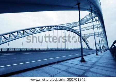 Modern bridge in China, night landscape. - stock photo