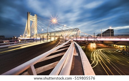 modern bridge with night traffic, Bucharest city, Romania
