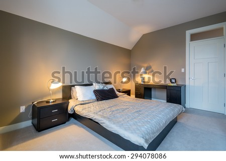 Modern bright bedroom interior design with night tables and office desk. - stock photo