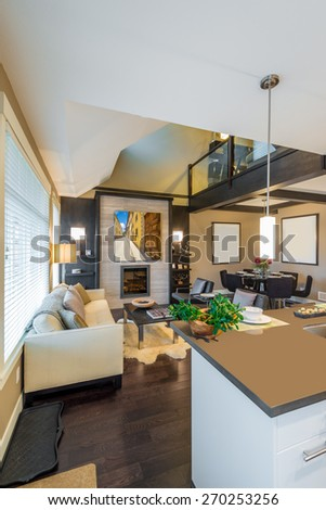 Modern, bright, clean, kitchen interior with stainless steel appliances in a luxury house - stock photo